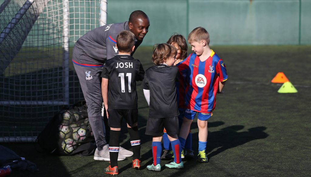 Young Crystal Palace fans being coached by Palace for Life Foundation coaches