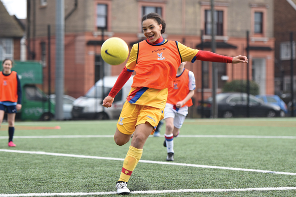 A girl playing football at a Palace for Life course