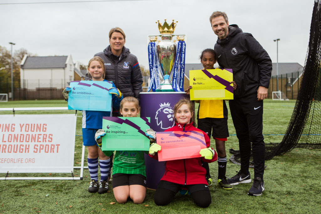 Young girls from south London pose with the Premier League trophy during FA Girls' Week
