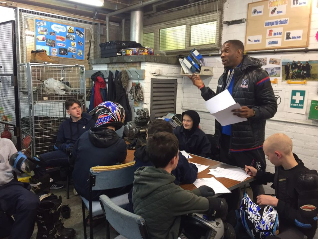 Participants on the bike mechanic programme being taught