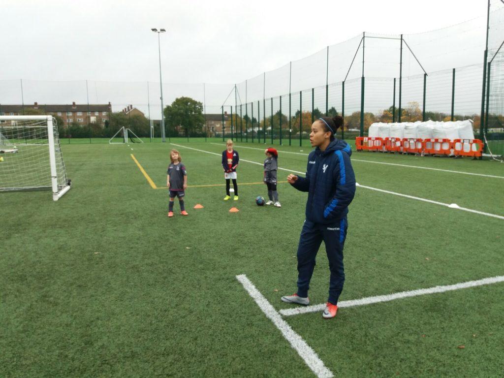 Pam McRoberts coaching children