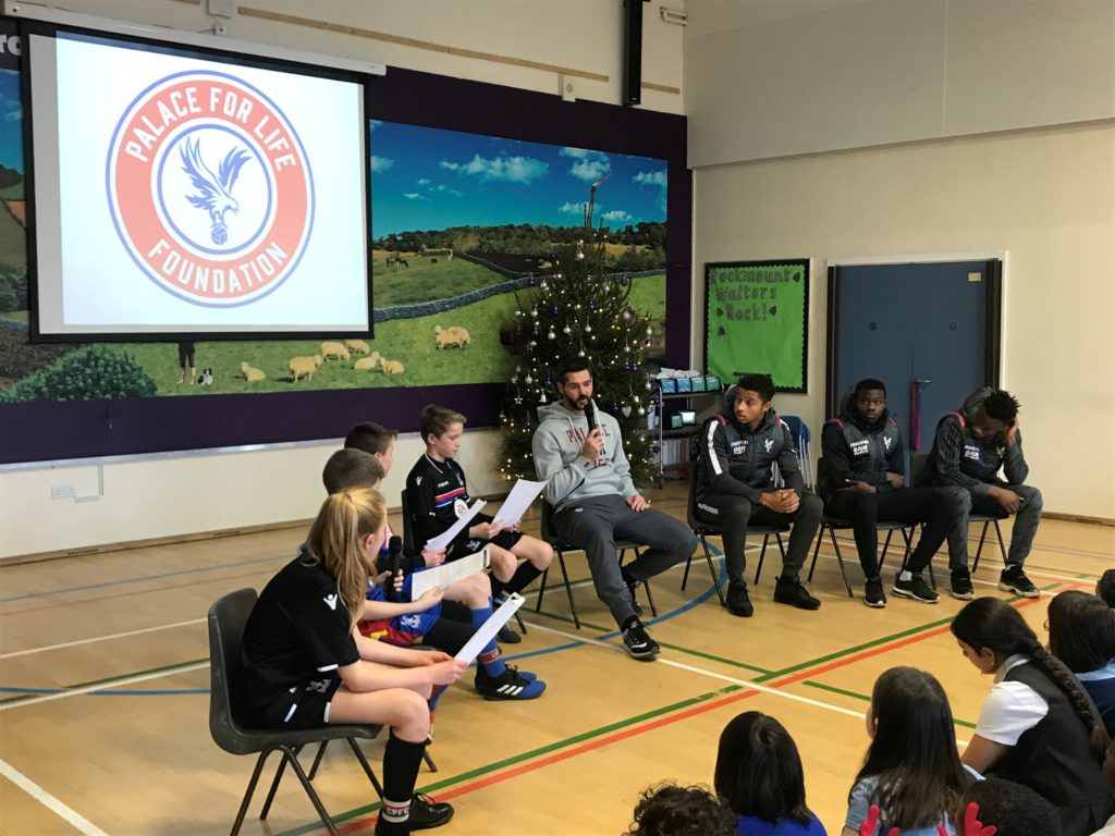 Julian Speroni and three Crystal Palace under 23s answering questions from children at Rockmount Primary School