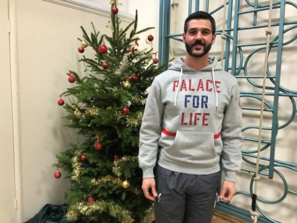 Palace keeper Julian Speroni wearing a Palace for Life hoody at Rockmount Primary School