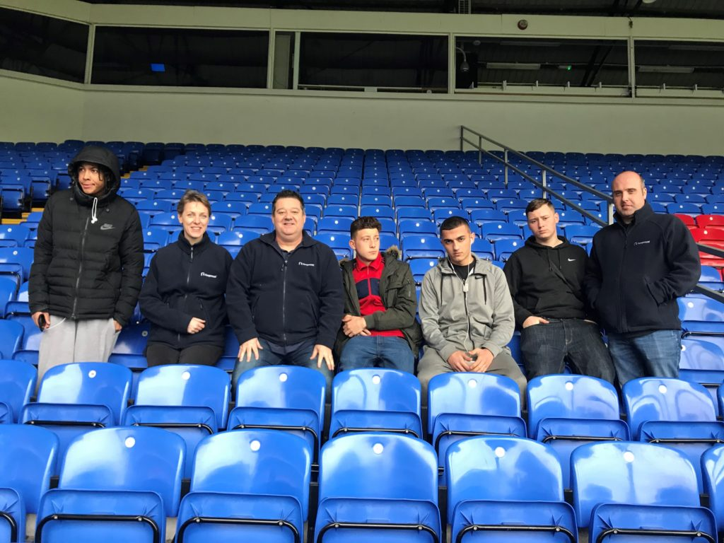 Youngsters from the PL Works programme sitting in the stands at Selhurst Park