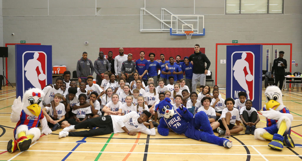 Crystal Palace players and mascots along with the Philadelphia 76ers players and mascots and Palace for Life Foundation participants during the NBA London event at City Sports with the Philadelphia 76ers ahead of their training session, on 9th January 2018 at City Sports, London