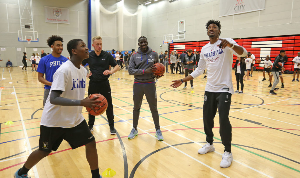 Mamadou Sakho of Crystal Palace and Robert Covington of Philadelphia 76ers during the NBA London event with the Philadelphia 76ers tahead of there training session, on 9th January 2018 at City Sports, London