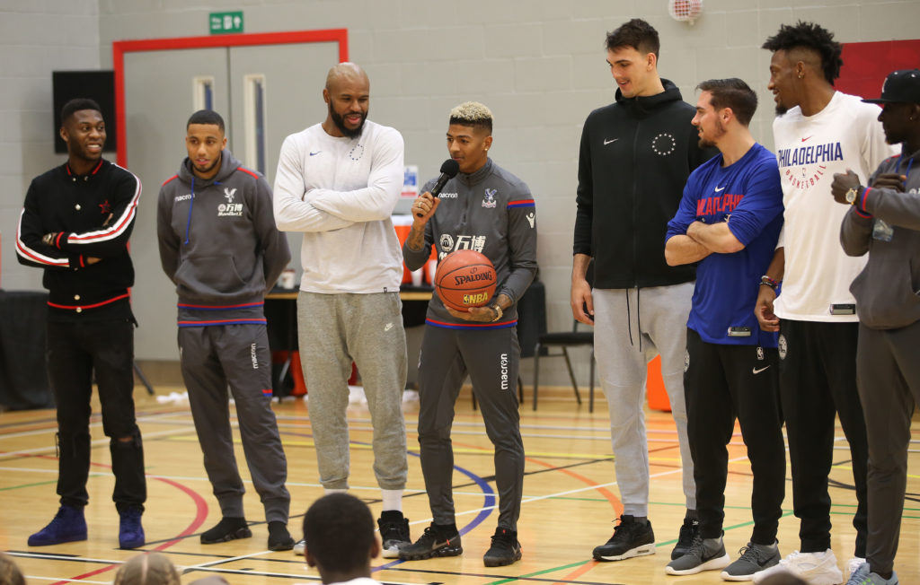 Patrick van Aanholt of Crystal Palace talks to the children during NBA London event with the Philadelphia 76ers ahead of their training session, on 9th January 2018 at City Sports, London