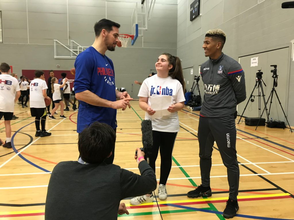 Ella, from Woodcote High School, interviewing TJ McConnell of the Philadelphia 76ers and Patrick van Aanholt of Crystal Palace