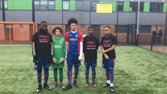 Players wearing Football v Homophobia t-shirts before the game