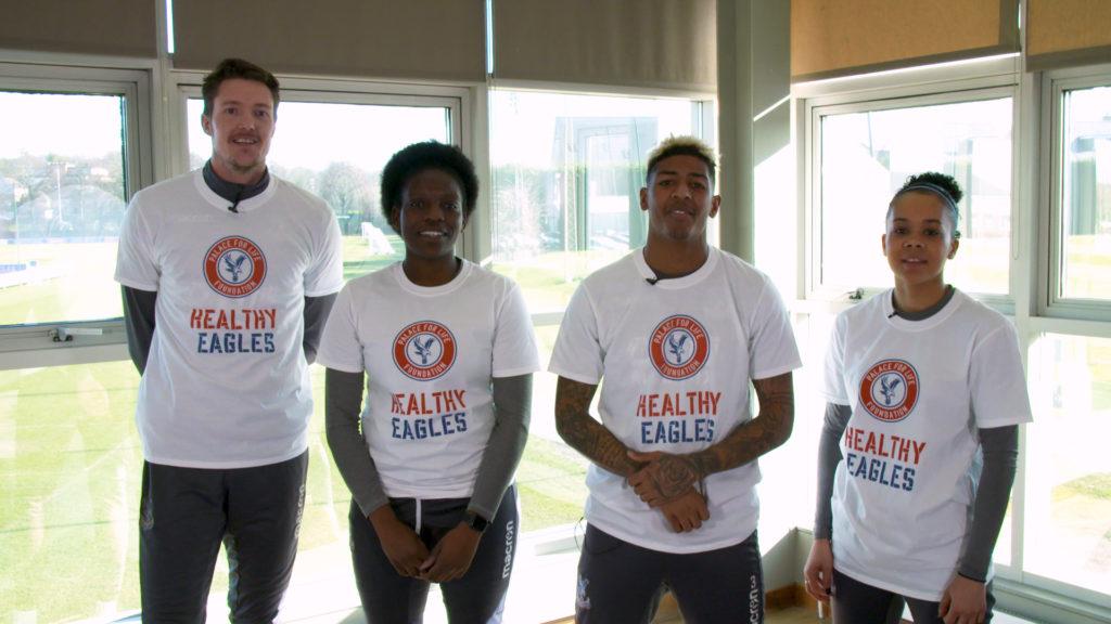 Wayne Hennessey, Patrick van Aanholt, Pam McRoberts and Natasha Ogbe wearing Healthy Eagles t-shirts