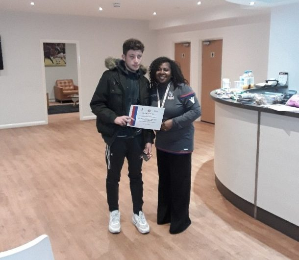 Jay receiving his certificate alongside Palace for Life Foundation's Deputy Head of Community Development, Susan Patterson-Smith