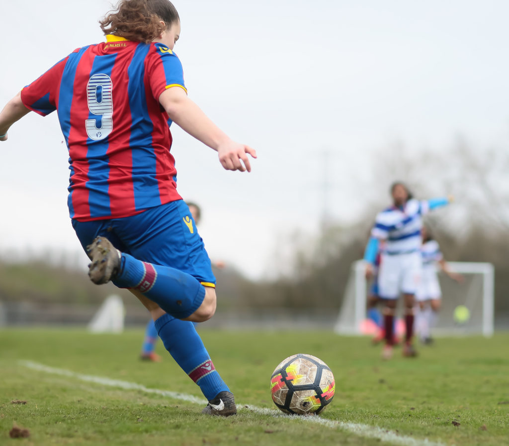 The girls team in action against QPR