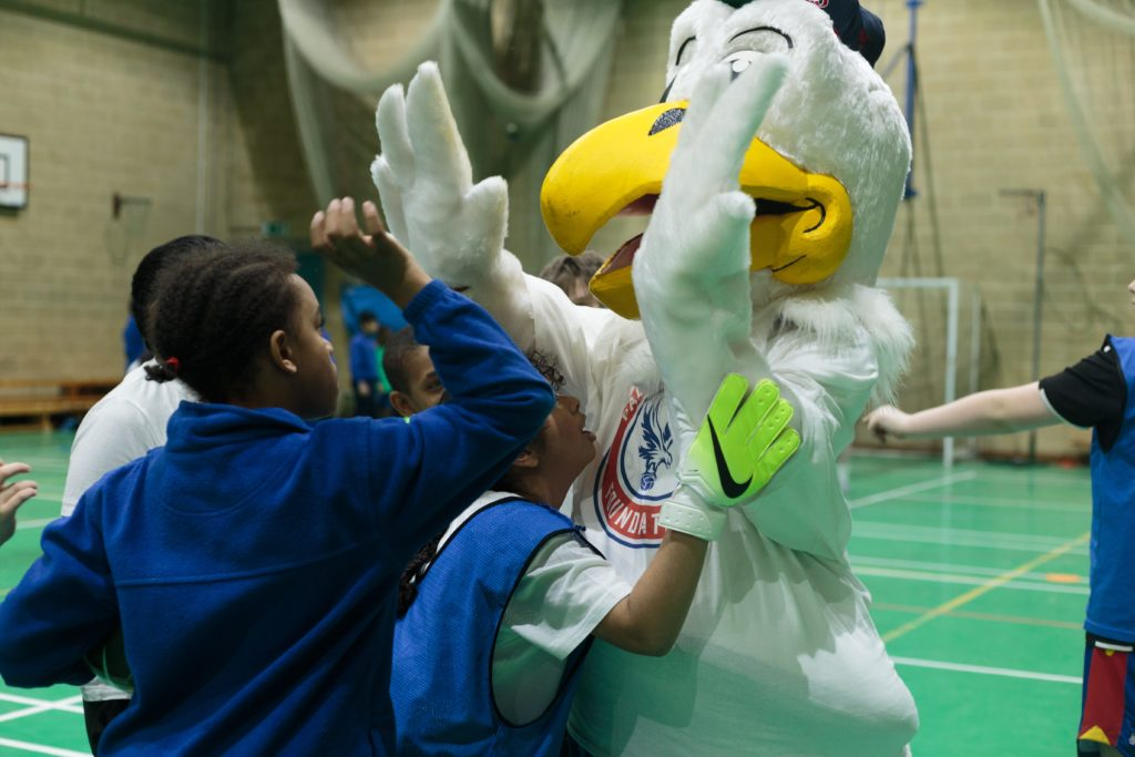 Palace mascot Chris the Eagle interacts with some of the children
