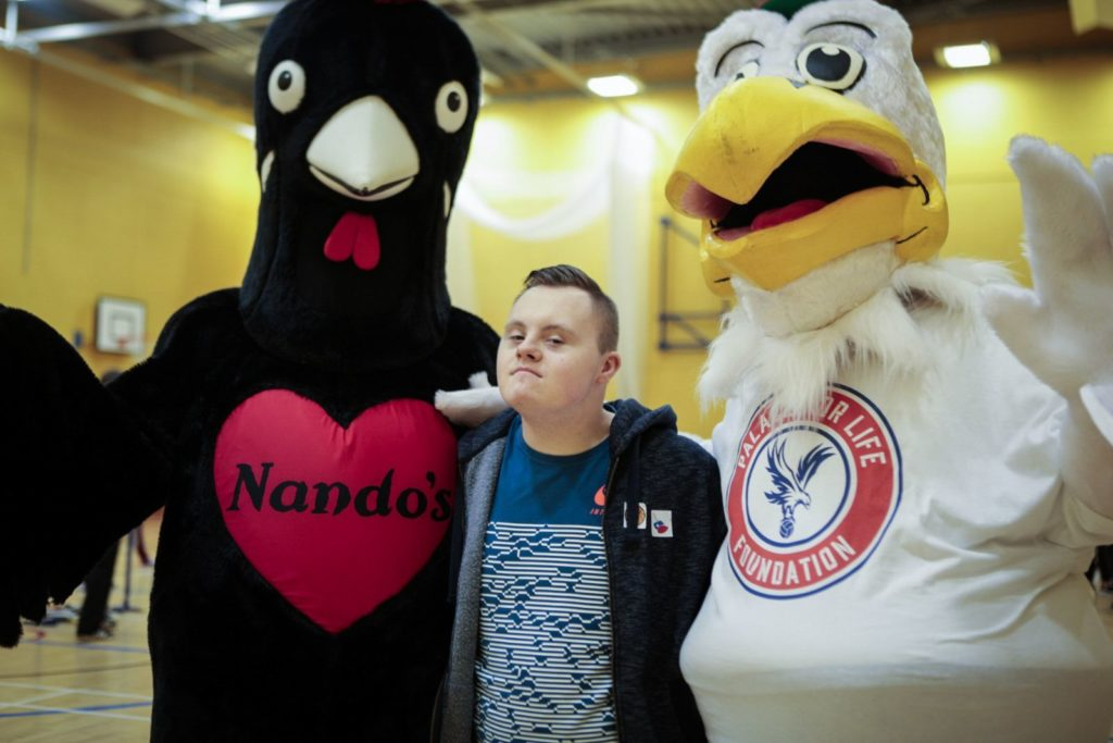 Participant poses with Palace and Nandos mascots