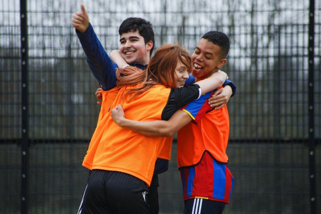 Participants celebrate a goal