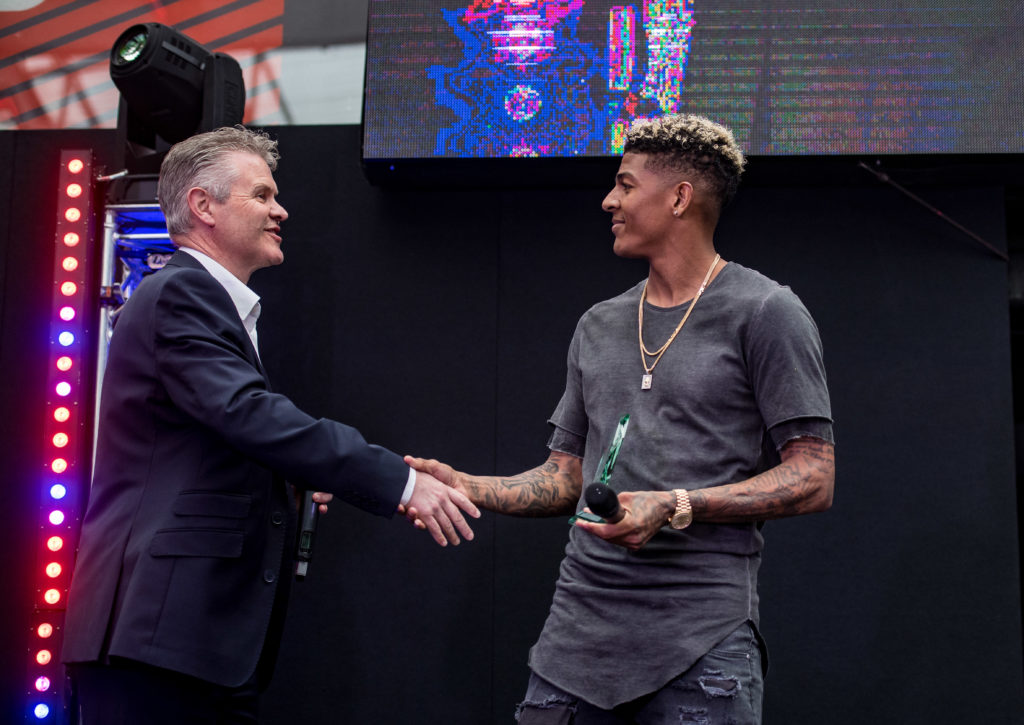 Van Aanholt receiving the award on stage with Foundation CEO Mike Summers