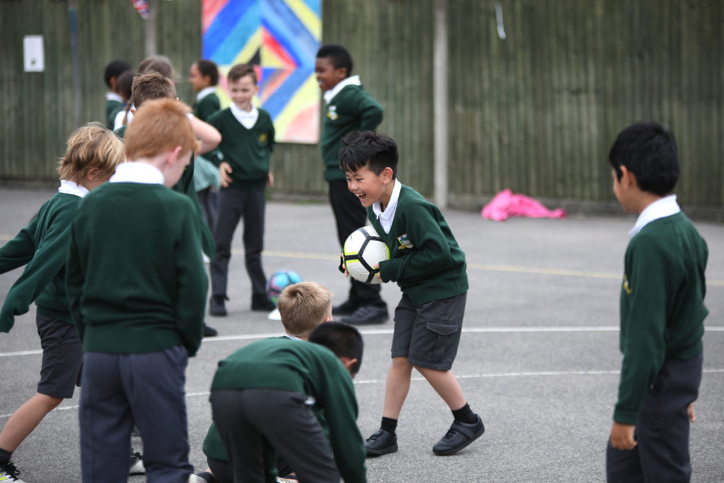 Children taking part in playground activities