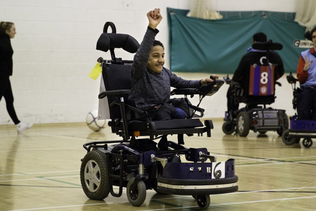 Powerchair football team in action