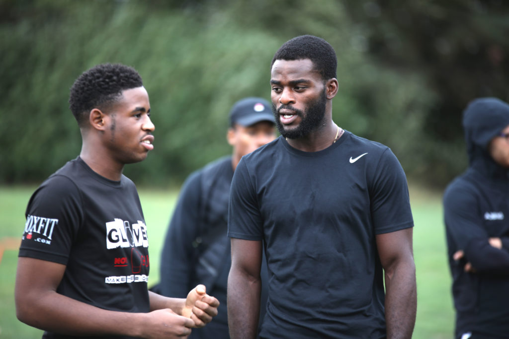 Joshua Buatsi talks to a young coach at Gloves not Gunz