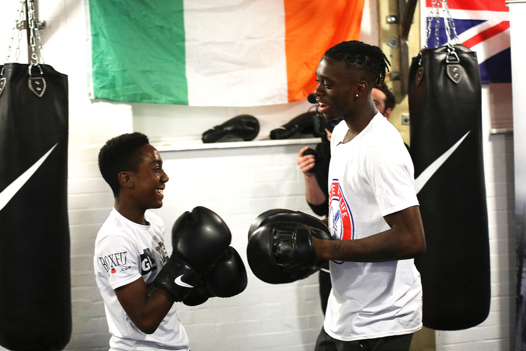Aaron Wan-Bissaka with young boxer at Gloves not Gunz