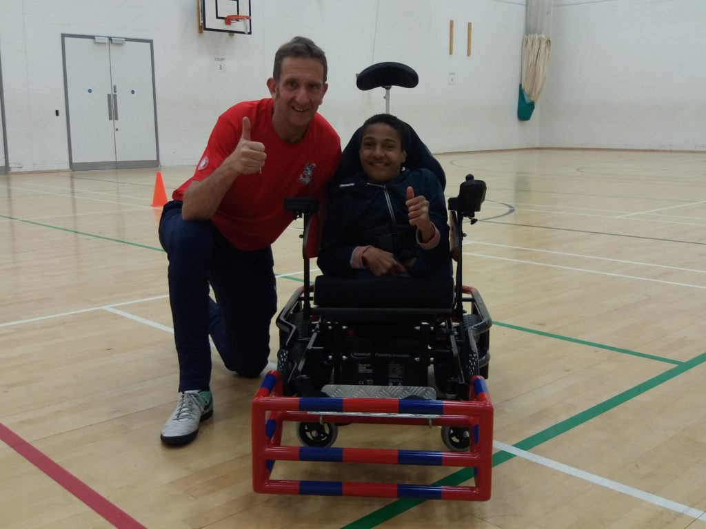 Powerchair footballer Joel with coach Michael Harrington